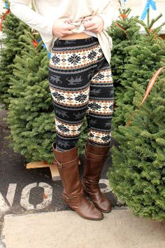They're like a sweater but for your legs! Cozy fleece lined leggings with a fun, nordic winter print throughout. Medium rise. Just Basics Tee- Oatmeal Silver Bells Necklace 92% Polyester 8% Spandex On
