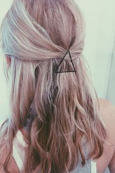 Take 3 bobby pins and make a triangle for an easy and pretty half up do