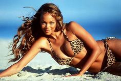 Tyra Banks, first African American model to appear on the cover of Sports Illustrated, 1996.