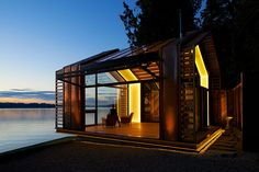 Aeattle and Amsterdam-based design collective graypants debuts the 'garage' restoration project right on edge of puget sound. Originally a dilapidated garage from the post world war II era, the project set out to update the structure's use as a residential cabin that preserved the intricacies and stories of the old construction.