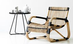 Chair CURVE features unique shaping and traditional craftsmanship from sustainable natural rattan. Light weight & very strong. Now available at polspotten store in Amsterdam.