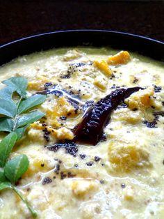 Mambazha Puliseri  ( Ripe mangoes cooked in  a creamy yogurt coconut gravy )