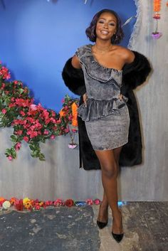Justine Skye denim one arm dress with ruffles. London Fashion Week: Front Row And Parties Gallery Pictures   British Vogue #denim #dress #ruffles
