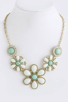 Mint daisy necklace! This website has amazing colorful statement jewelry at great prices!