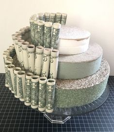 Cake stand + Styrofoam discs + rolled bills secured with clear plastic bands sec. Cake stand + Styrofoam discs + rolled bills secured with clear plastic bands secured to foam via straight pins. Graduation Party Decor, Grad Parties, Graduation Ideas, Graduation Celebration, Graduation Gift Baskets, College Graduation Cakes, Graduation Desserts, Graduation Party Centerpieces, 8th Grade Graduation