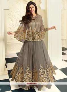 Spread the aura of freshness with this Shilpa Shetty grey net anarkali salwar kameez showing a touch of sensuality. The resham and embroidered work looks chic and perfect for any occasion. Indian Fashion Dresses, Indian Gowns Dresses, Dress Indian Style, Pakistani Dresses, Indian Outfits, Flapper Dresses, Long Dresses, Designer Anarkali, Anarkali Dress