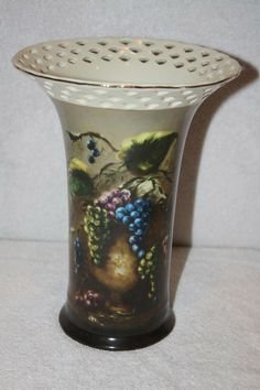 """This is a beautiful grape design ceramic porcelain vase by Lisa White Vineyard Blessings. It measures approx: 9 3/4"""" x 7""""D x 4 1/4""""D base and is in MINT condition  and has gold trim.  $65 FREE SHIPPING TO US RESIDENCE I do combine shipping. Please email me with any questions. Thank  you Vases For Sale, Porcelain Vase, Blessings, Vineyard, Lisa, Ceramics, Free Shipping, Gold, Beautiful"""