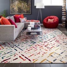 This area rug features Lilting in Titanium, Marigold, Berry and Teal. This area rug contains diagonal cut tiles. To assemble your rug, just use the FLORdots in the box with your squares.