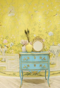 Sunny yellow strewn with vines, birds and gorgeous flowers creates a stunning example of unexpected color in Chinoiserie. The turquoise and gold chest is gorgeous against the wallpaper.