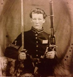 An unidentified Union Cavalry soldier with a sword and gun, ca. 1861-1865.