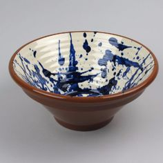 These terracotta bowls and dishes are made in Portugal. The dark blue splatter design on cream background offsets almost all foods. As the splatter design is applied by hand each bowl has slightly different decoration.