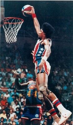 ABA player Dr J. I was lucky enough as a kid to witness two of his signature moves when they happened. I will always remember the dunk against Michael Cooper and the Lakers. It's a play that as a kid watching, made me love the game of basketball.