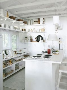 Kinda like the shelf idea instead of cupboards, especially in a small kitchen