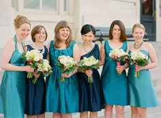 Alfred Sung bridesmaid dresses.  I like the mix of colors and dress styles.  Colors: Caspian and Niagara (I believe).