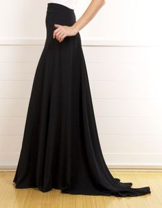 Chanel Silk Black Evening Skirt. This gorgeous black skirt is absolutely stunning! It is longer in the back to create a beautiful train