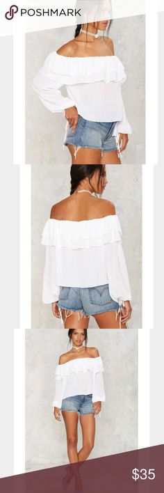 Black Ruffle Off Shoulder Blouse New without tags: A brand-new, unused,  and unworn item. The original tags may not be attached. **nasty gal item refer to site for sizing guide**  NO Trades   NO Holds (whoever first come to buy unless note otherwise) Nasty Gal Tops Blouses