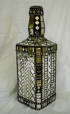 This is a large size Jack Daniels bottle that I have rescued from a trip to the landfill, and repurposed with mosaic mirror tiles, ball chain and Mosaic Bottles, Mosaic Vase, Mirror Mosaic, Mosaic Diy, Mosaic Crafts, Glass Bottles, Mirror Tiles, Wine Bottles, Mosaic Planters