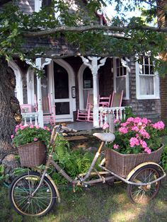 sweet little gray cottage with pink porch furniture