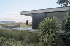 The Coromandel's gritty persona marries smooth-cut family living in this neutral-hued home, designed by Neu Architecture. Slide Screen, New Zealand Houses, Exposed Concrete, Dining Room Walls, Main Entrance, The Dunes, Clever Design, White Walls, Facade