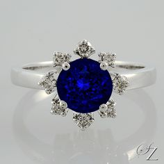 A modern classic featuring this mesmerizing Tanzanite that draws you deep into its magical depths. Delicate Diamond brilliants set individually around the Tanzanite like tiny petals and add that extra special sparkle.