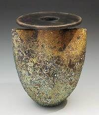 Raku by Melanie Ferguson:  http://melaniefergusonceramics.com/GalleryMain.asp?GalleryID=129192&AKey=APSX3K7X