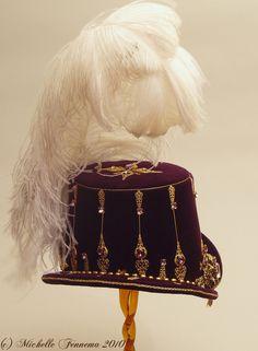 Artemis (side)--Eggplant velvet, gold chain, freshwater pearls, swarovski crystals, brass findings, vintage brooch. Elizabethan tall hat created by Michelle Fennema 2010.