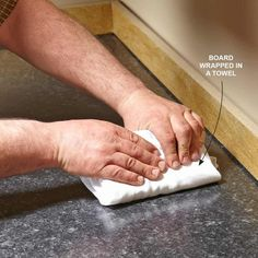 Smooth Laminate With a Board - Installing Laminate Countertops: http://www.familyhandyman.com/kitchen/countertops/installing-laminate-countertops
