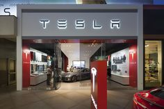 Alameda make the most of Tesla's 892 square foot showroom in Beverly Hills. The open glazed frontage and clever use of wall fixture for displaying products maximises the available space and incorporates all of Tesla's signature showroom components.