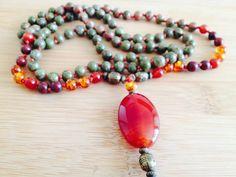 Japamala handmade of Unakite, amber, cornaline, red jasper.