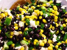 Ingredients    • 1 can of Bush's black beans  • 1 can of Del Monte whole kernel yellow corn  • 1 bunch of green onions  • 1/4 cup of apple cider vinegar  • 1 tablespoon of olive oil  • 1 tablespoon of sugar (or two packets of Splenda)*  • 3/4 – 1 cup of crumbled feta. Stir carefully so the feta doesn't fall apart.  Serve with Tostitos Scoops.