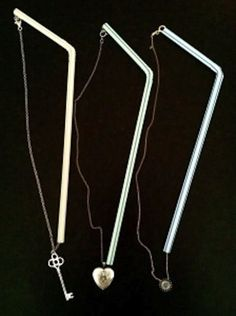 thread necklaces through drinking straws to avoid tangles