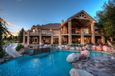 Rustic Swimming Pool with flush light, Exposed beam, Wall sconce, slate floors