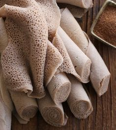 Injera, a spongy sourdough flatbread, is perhaps the most important food item in Ethiopian cuisine. Injera serves not only as a kind of bread, but also as an eating utensil. Ethiopian Bread, Ethiopian Injera, Ethiopian Cuisine, Ethiopian Recipes, Ethiopian Restaurant, Teff Recipes, Bread Recipes, Cooking Recipes, Easy Recipes