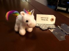 A needle felted unicorn designed and made by Carren Lu (www.artistic-touch.co.uk)