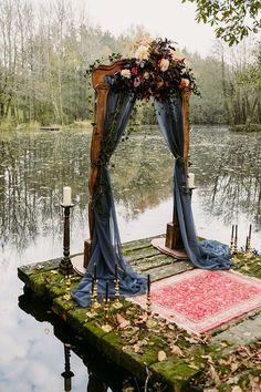 Rustic arch, vintage rug and candlesticks by the lake for a wedding ceremony. #wedding #weddingfashion #whiterunway #bridalfashion #bridesmaids #rustic