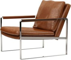 Mid-century meets modern luxe. The Class leather armchair exhibits a sleek silouette, featuring premium bicast leather upholstery. Padded leather arms adorn the angled flatbar stainless steel frame co