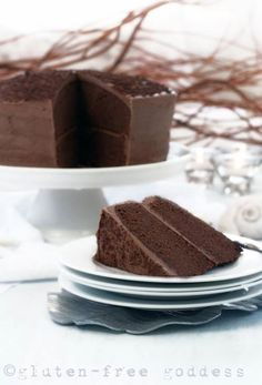This dense, rich chocolate layer cake with mocha frosting is party worthy.  https://glutenfreegoddess.blogspot.com/2012/12/gluten-free-chocolate-layer-cake.html #glutenfree #chocolatechip #glutenfreerecipes