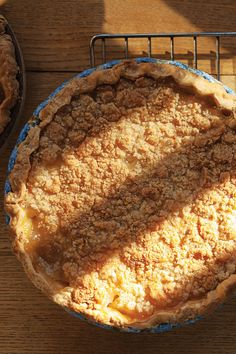 Fresh ginger gives the filling of this pear pie a warming kick of spice, balanced by the buttery crumble of sweet streusel.