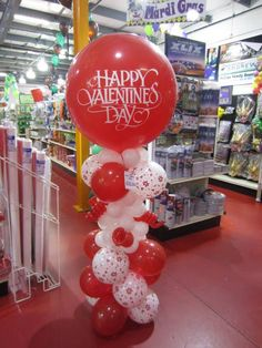 Decorate your space with red, pink and white Valentine columns like this one from our crew in Tyler! Visit your local Wally's to place an order before Valentine's Day! #ballooncolumn #ValentinesDay