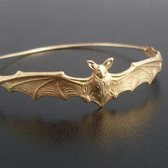 Bat Bangle Bracelet Gold Tone Animal Bracelet by FrostedWillow.  Want it.....bad!