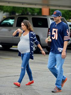 Mila Kunis still fits into her skinny jeans outing with Ashton Kutcher She may be due to give birth any day now, but other than a gorgeous baby belly that is impossible to miss, the doesn't appear to have put on an ounce anywhere else Cute Maternity Outfits, Stylish Maternity, Maternity Wear, Maternity Styles, Celebrity Maternity, Maternity Jacket, Maternity Swimwear, Pregnancy Looks, Pregnancy Photos