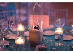 Love the linen texture and the floating tealights! perfect for my beach bling wedding. Found on Weddingbee.com Share your inspiration today!