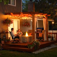 deck with fire pit and lighting