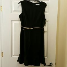 "SPECIAL OFFER NEW Calvin Klein  Black Dress Classic Calvin Klein sleeveless black dress with hidden zipper and belt. Has mini box pleats with chiffon.  Fabric is 63% polyester  and 33% rayon. Measures about 38"" from shoulder to bottom of hem. Size 12 FOR A LIMITED TIME  Calvin Klein Dresses Midi"