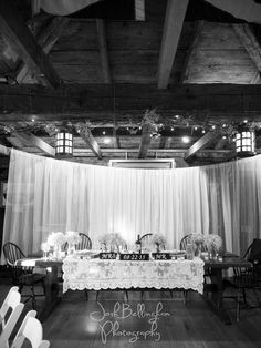 A Black and White shot of the head table. Navy Hall is a perfect location for a rustic  barn style wedding. #JoshBellinghamPhotography
