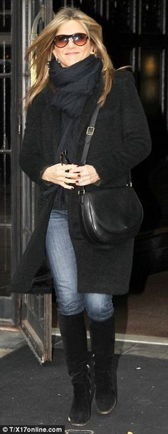They've found their winter staples! Justin Theroux and Jennifer Aniston were seen recycling a stylish jacket and coat for their day out in New York City on Sunday; the couple were previously seen clad in the pieces on Friday