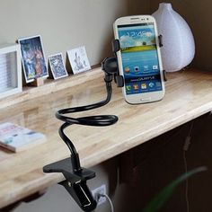 Layze Phone Holder is strong and flexible to bend in any direction while holding your phone.360 rotating head allows your phone to be horizontal, vertical, or diagonal.Universal fit for ALL phones.Great for hands free movie watching, voice calls, picture taking, and video recording.No need to worry about getting your phone dirty while cooking, just clip it anywhere in your kitchen.Use it in your Kitchen, Bedroom, Bathroom, Car, Outside, the possibilities are endless!