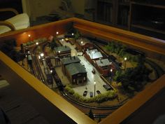Train set inside an Ikea Vinninga coffee table. - LOVE THIS for a future kids' room.