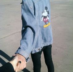 × Disney denim jackets and black trousers