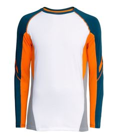 9f049f25e Men s long-sleeved sports shirt in breathable fabric with orange   blue  details.